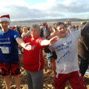 Reverend Robert Jennings (right) at the Christmas swim