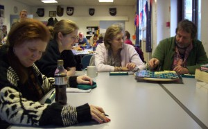 Volunteer Shana helps at the Scrabble table